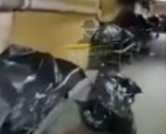 На видео сняли забитый трупами подвал ковидного госпиталя
