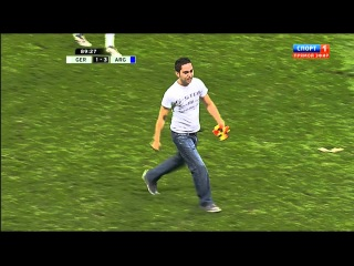 Lionel Messi shakes a pitch invader's hand v Germany