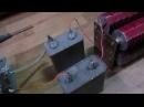 влияние конденсатора во вторичной цепи трансформатора на ток в первичной обмотке.