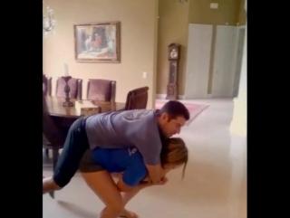 Cute girl lifting guy
