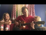 Chad VanGaalen and his daughters perform