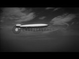 LZ 129 Hindenburg in flight over New York-New Jersey shores as seen from a plane ...HD Stock Footage