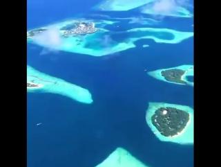 Мальдивы из окна самолета.mp4
