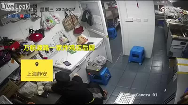 The explosion of a delivery electric motorcycle battery while charging in a kitchen in JingAn Shanghai