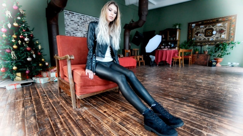 Blonde in Boots in leather leggings leather pants