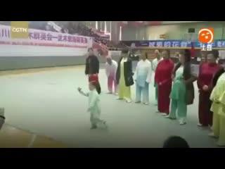 Three years old little girl tai chi practice