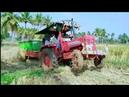Mahindra 475 stuck in heavy mud Mahindra Novo 605 harvester pulling