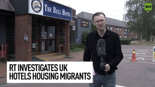 Police stop RT as we investigate the controversy of migrants living in UK hotels