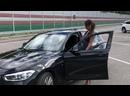 Елена Беркова тестирует водительское кресло BMW 118i